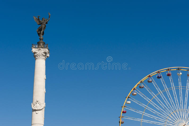 Big wheel and Statue of Girondins Bordeaux, France royalty free stock photo