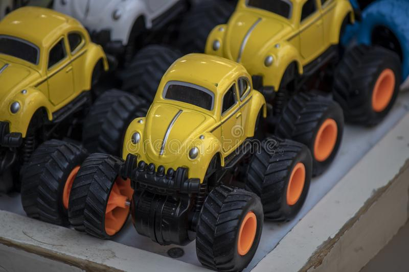 Big wheeled jeep in front of toy store.  stock photos