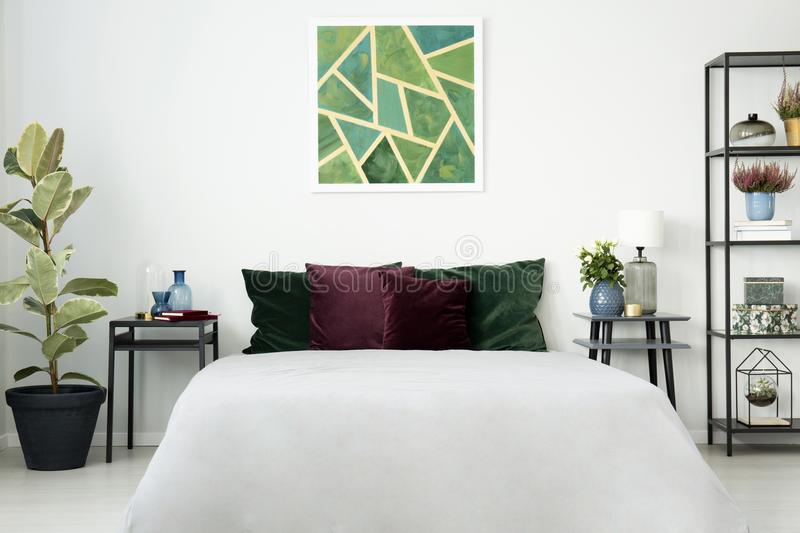 Big white bed with cushions stock photo