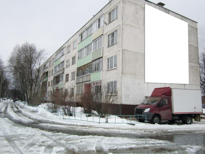 Big white billboard on a block of flats, mockup royalty free stock image
