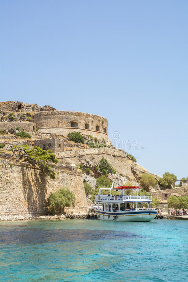 Big white boat near the castle on the island of Spinalonga royalty free stock images