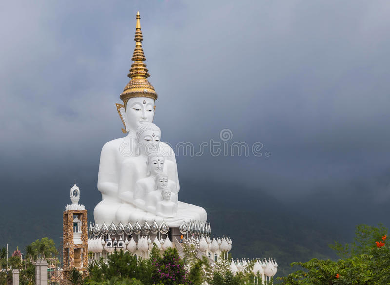 Big white buddha statues sitting in Wat Phra That Pha Son Kaew in thailand stock images