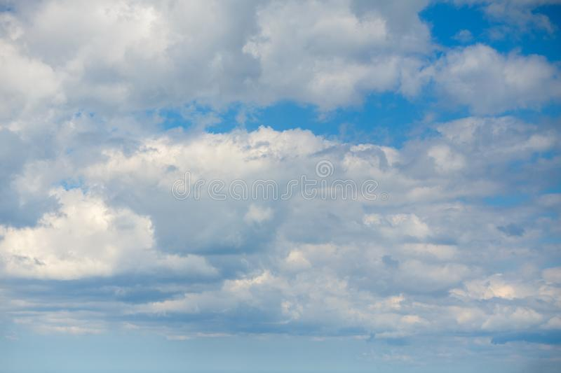 Big white clouds in blue sky, beautiful background stock image