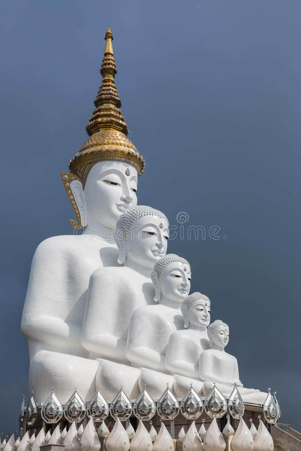 Big white five buddha statues sitting in Wat Phra That Pha Son Kaew temple stock images