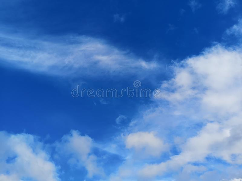 Big white fluffy clouds in the blue sky.Summer background royalty free stock photography