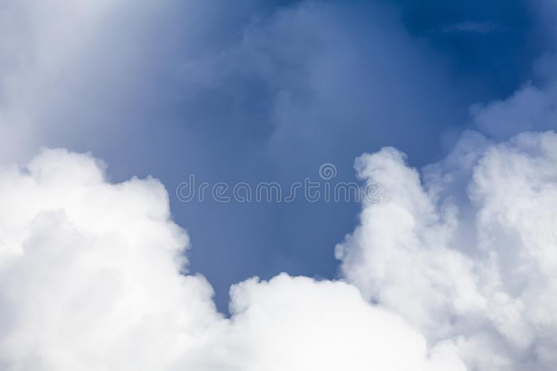 Big white puffy clouds and blue sky background 0114 royalty free stock photos