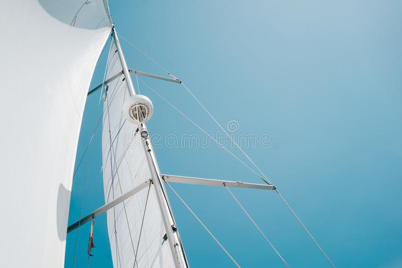 Big white sail of a sailing boat against the sky.  stock photography