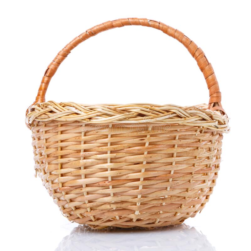 Big wicker basket on a white background. The basket is made of vines royalty free stock photos