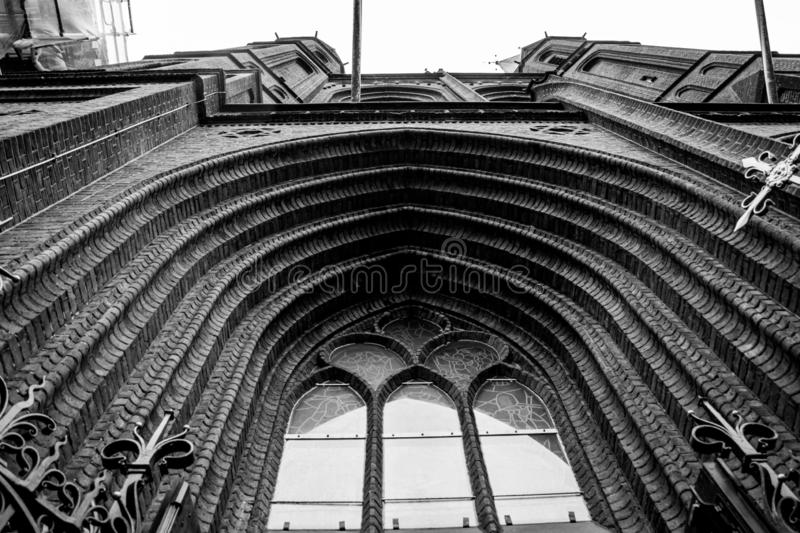Big window on a gothic structure. Old, building, architecture, glasses, culture, religion, style, history, design, ancient, tour, tourism, travel, exterior stock photos