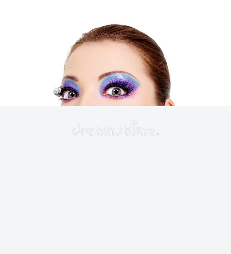 Download Big Wondering Femalel Eyes And Blank Banner Stock Image - Image: 12199019