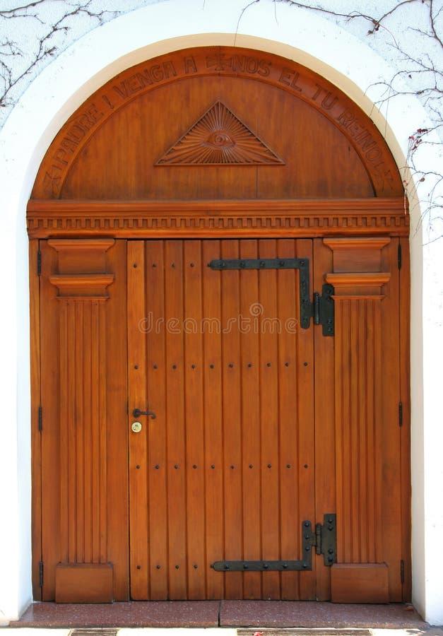 Big wooden door of a church stock photos