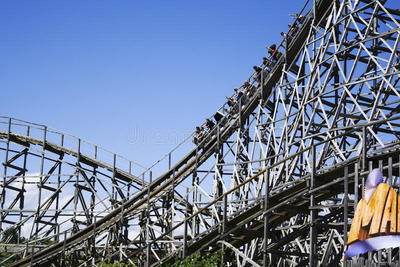 Big slope on a ride of a giant roller coaster royalty free stock photo