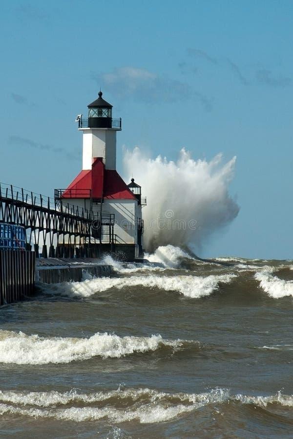 Big WOOSH! wave and michigan lighthouse royalty free stock photos