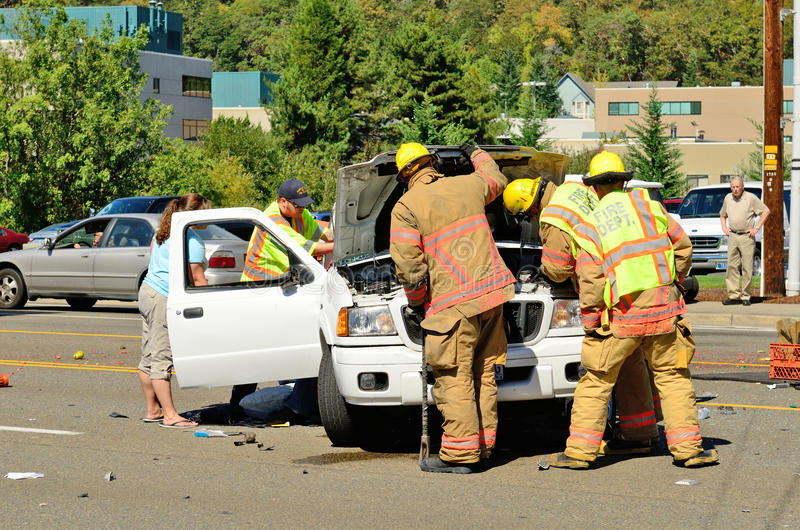Big Wreck. Firefighters and paramedics extricate the victims of a two vehicle t-bone type accident at an intersection resulted in major jinjuries due to failure stock photography
