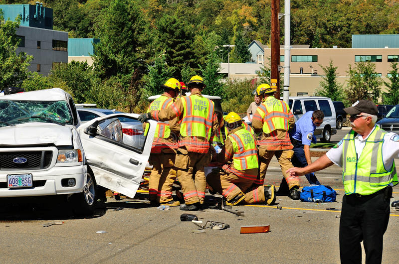 Big Wreck. Firefighters and paramedics extricate the victims of a two vehicle t-bone type accident at an intersection resulted in major jinjuries due to failure royalty free stock photography