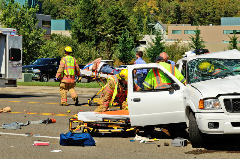 Big Wreck. Firefighters and paramedics extricate the victims of a two vehicle t-bone type accident at an intersection resulted in major jinjuries due to failure royalty free stock image