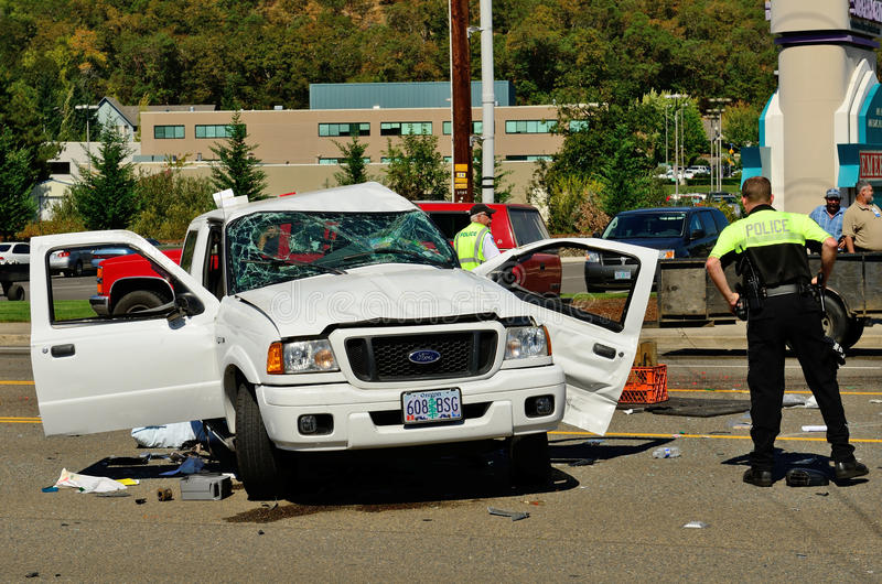 Big Wreck. Firefighters and paramedics extricate the victims of a two vehicle t-bone type accident at an intersection resulted in major jinjuries due to failure stock photos