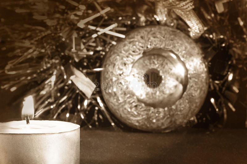 Big xmas ball with candle and tinsel, selective focus, vintage stock photos