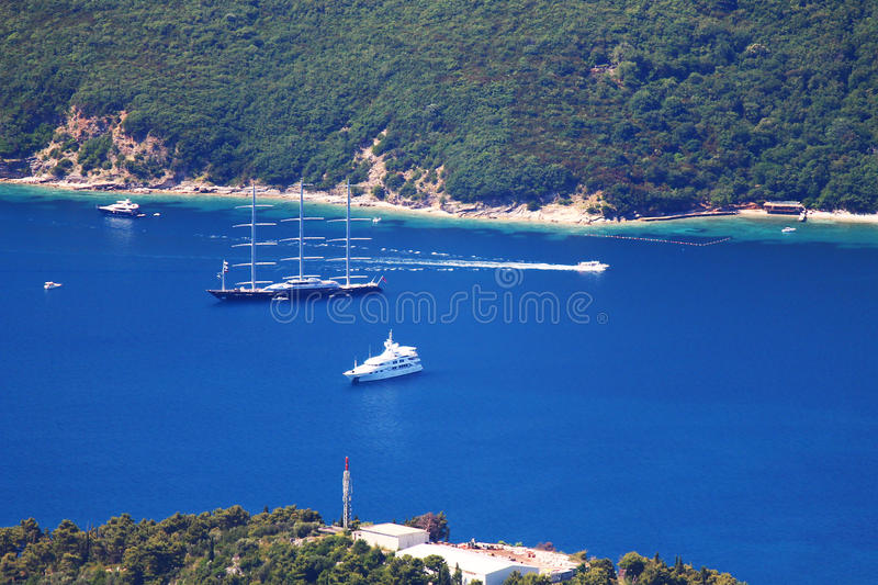 Big yacht on blue water near shore royalty free stock photography