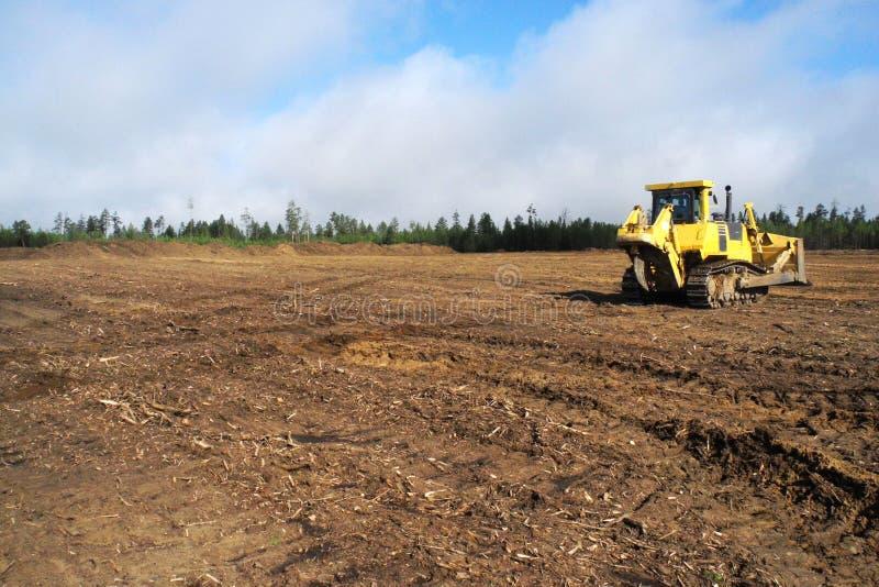 Bulldozer at construction site royalty free stock photo