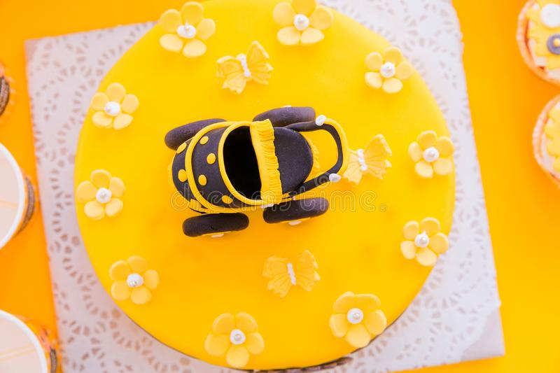 Big yellow cake in honor of the child`s birthday.Top view royalty free stock photography