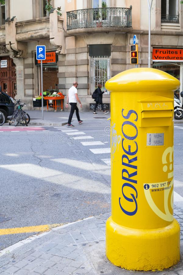 Big yellow mailbox at the crossways in the capital of Catalonia. Barcelona, Spain - May 5 2016. Big yellow mailbox at the crossways in the capital of Catalonia stock photography