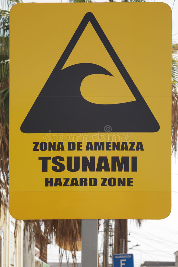 Big yellow tsunami warning sign on the street of Iquique Chile stock photos