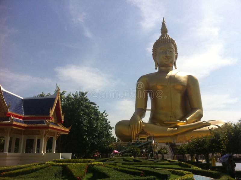 The bigest buddha and thai church on blue sky background. The big buddha and thai church on blue sky background from thailand stock photography