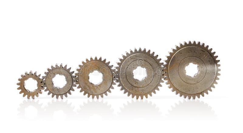 Bigger Cog Wheels. Different sizes of old metallic cog wheels royalty free stock photos