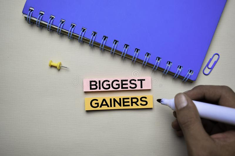 Biggest Gainers text on sticky notes with office desk. Stock Market Exchange Concept stock photos