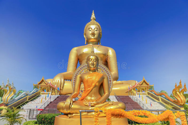 biggest golden buddha statue in wat muang public temple at angthong province, thailand stock photography