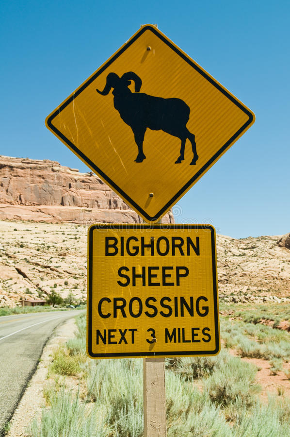 Bighorn Sheep Crossing. Road sign, Arches National Park, Moab, Utah stock images