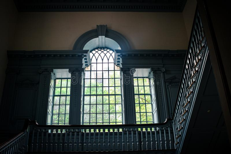Beautiful Large multi paned window window and stairway in Independence Hall royalty free stock photography