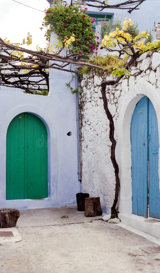 Brightly Painted Doors in Crete, Greece stock photo