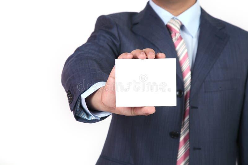 Biglietto da visita in bianco in una mano immagine stock
