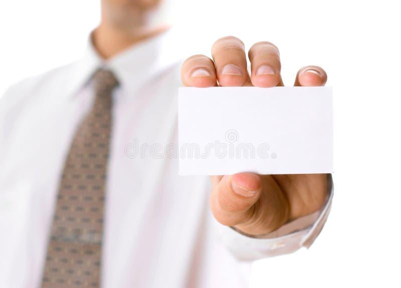 Biglietto da visita della tenuta dell'uomo di affari fotografie stock