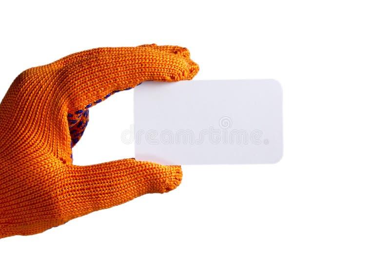 Biglietto da visita a disposizione in guanto arancio fotografia stock
