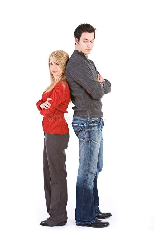 Biglietto di S. Valentino: Coppie arrabbiate di nuovo alla parte posteriore fotografia stock