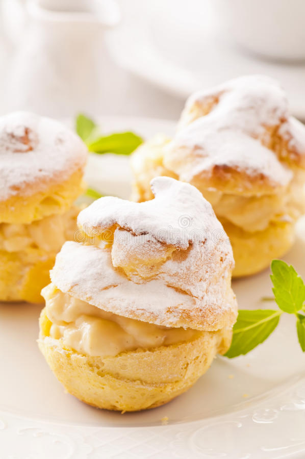 Bigne. With cream puff and powdered sugar stock photos