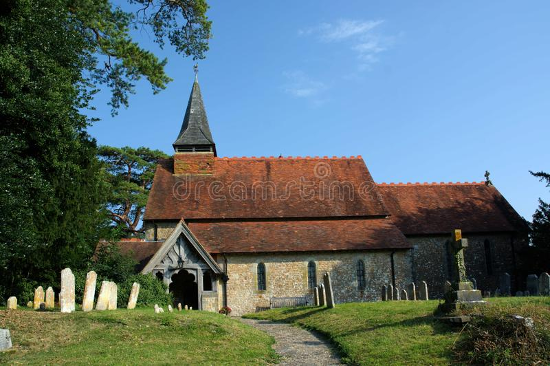 The Church of The Holy Cross, Bignor, Sussex, UK. Bignor is a village and civil parish in the Chichester district of the English county of West Sussex, about six royalty free stock image