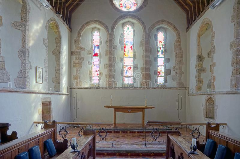 Altar of the Church of The Holy Cross, Bignor, Sussex, UK. Bignor is a village and civil parish in the Chichester district of the English county of West Sussex stock photo