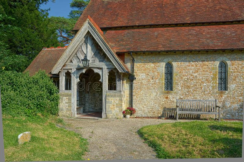 Entrance to the Church of The Holy Cross, Bignor, Sussex, UK. Bignor is a village and civil parish in the Chichester district of the English county of West royalty free stock images