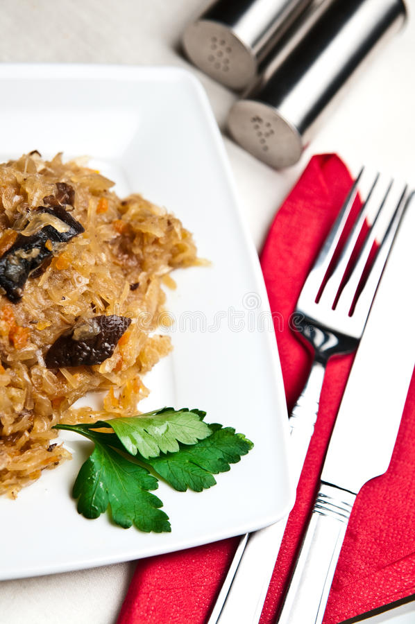 Bigos (Polish cuisine of cabbage food). An elegant plate of traditional Polish food bigos (cabbage served with meat, mushrooms and spices stock images