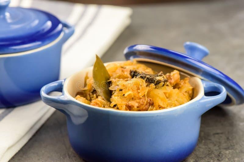 Traditional Polish food - bigos. Bigos - traditional Polish Easter and Christmas dish - closeup in blue bowl stock images