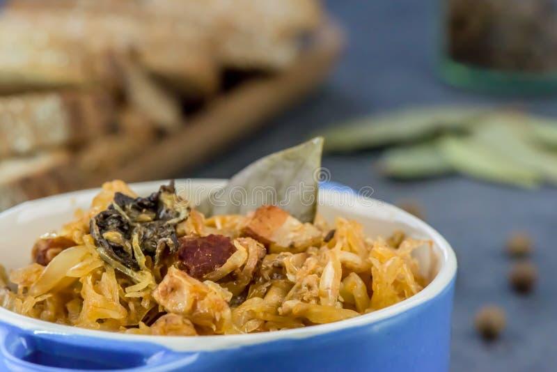 Traditional Polish food - bigos. Bigos - traditional Polish Easter and Christmas dish - closeup in blue bowl royalty free stock images