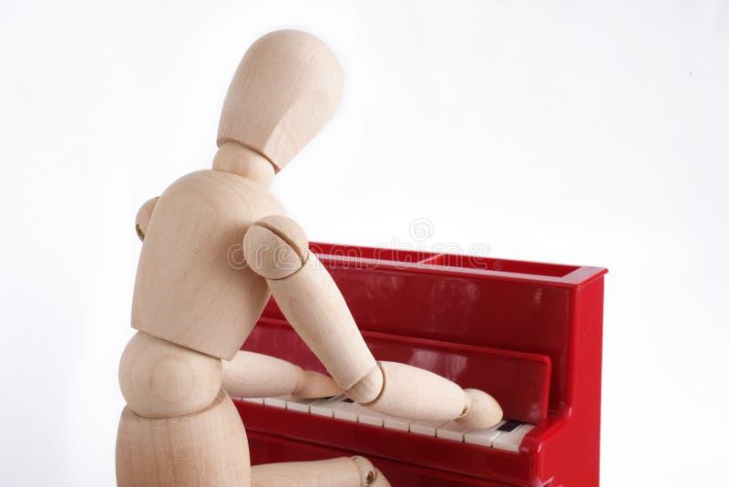 Bij de piano stock afbeeldingen