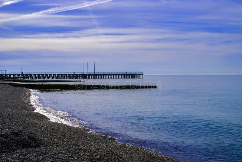 Bij strand blauwe breed stock foto