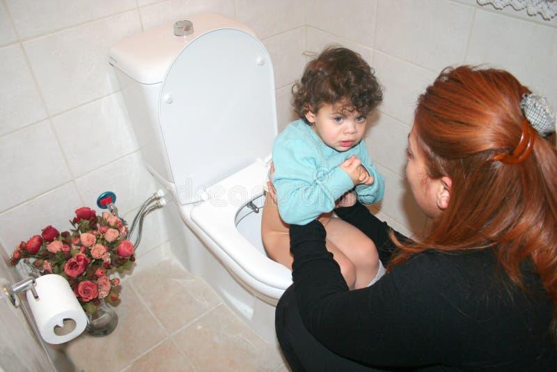 Bij toilet stock afbeelding
