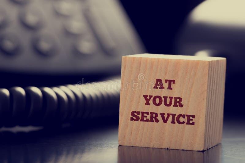 Bij Uw Dienst royalty-vrije stock afbeelding