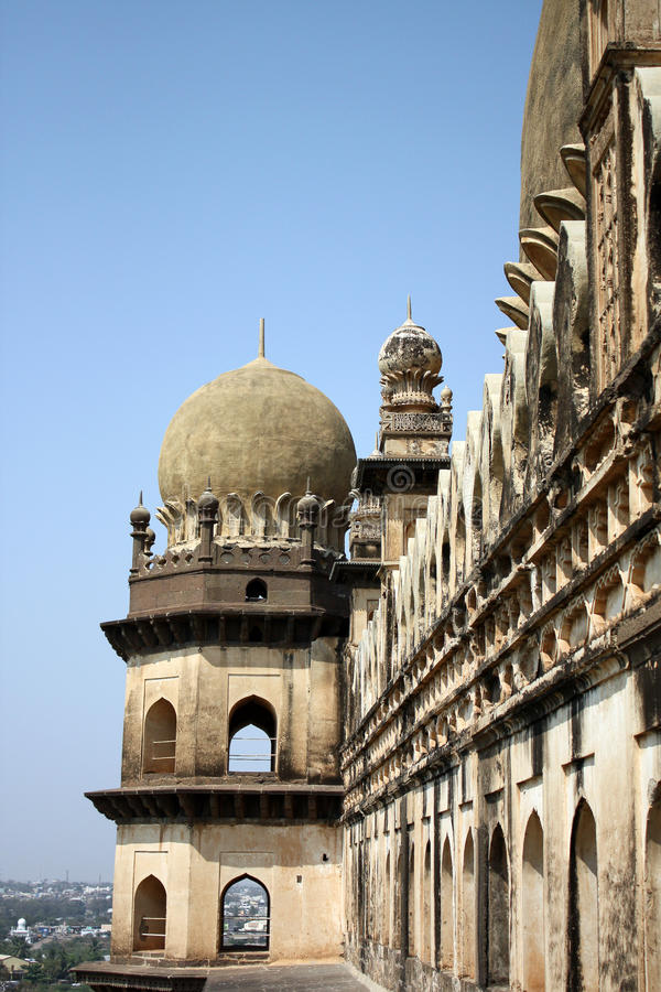 Bijapur Towers. A view of the beautiful architeture of the artistically carved towers of the Gol Gumaz, in Bijapur India. The dome happens to be the 2nd largest royalty free stock photo